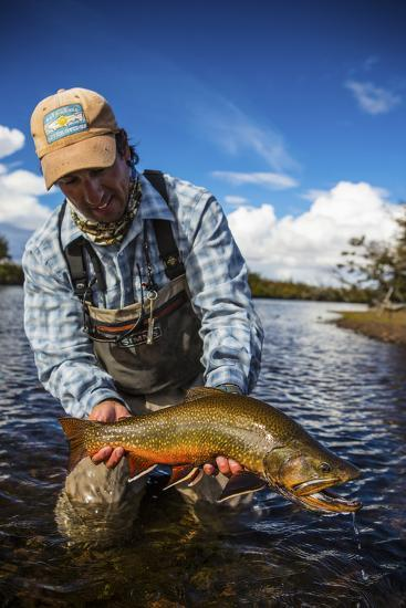 A Male Fly Fishing Guide Holds a Beautiful Male Brook Trout-Matt Jones-Photographic Print