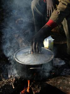 A Man, 24, from Ghana, Prepares His Meal