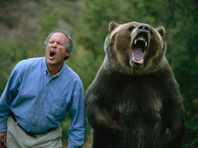 A Man and a Trained Grizzly Bear Snarl for the Camera-Joel Sartore-Photographic Print