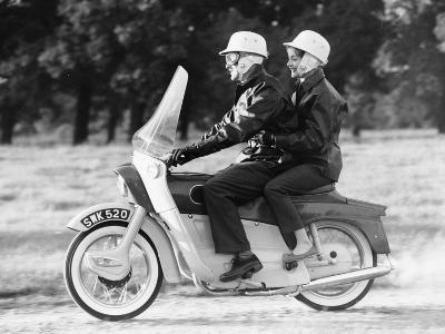 A Man and a Woman Riding an Ariel Leader, 1958--Photographic Print