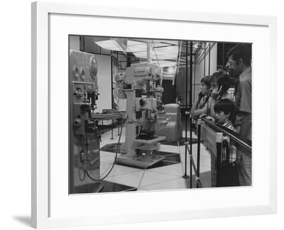 A Man and Three Boys Looking at a Display of Various Machine Tools--Framed Photographic Print