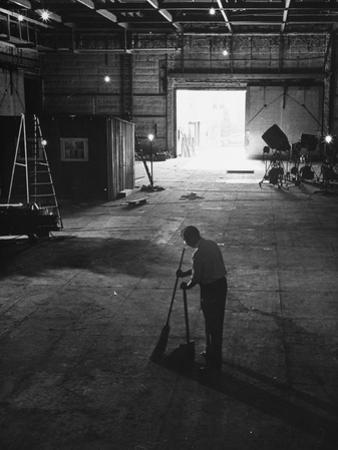 A Man Cleaning Up the Empty Sound Stage