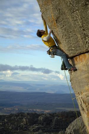 https://imgc.artprintimages.com/img/print/a-man-climbs-in-the-cederberg-wilderness-area-south-africa_u-l-pu6mma0.jpg?p=0