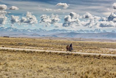 A Man Cycles with a Family Member on the Back of His Bicycle Between La Paz and Tiwanaku-Alex Saberi-Photographic Print