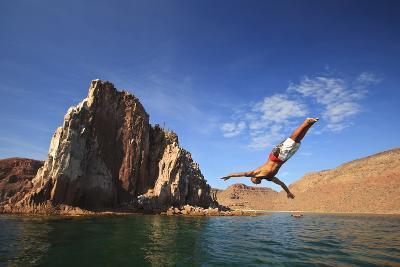A Man Dives into the Water Off Espiritu Santos Island Near La Paz; Baja California Mexico-Design Pics Inc-Photographic Print