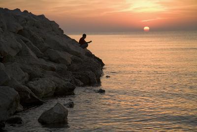 A Man Fishing at Sunrise on the Beach at Larnaka, Cyprus-Scott S^ Warren-Photographic Print