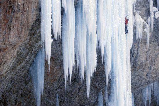 A Man Ice-Climbing an Ice Formation-Keith Ladzinski-Photographic Print