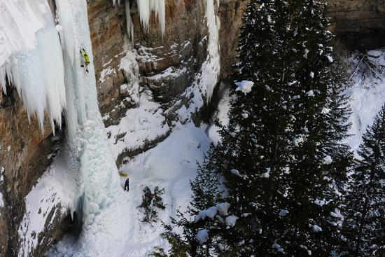 A Man Ice-Climbing the Fang, an Ice Formation on the Side of a Cliff-Keith Ladzinski-Photographic Print