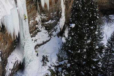 https://imgc.artprintimages.com/img/print/a-man-ice-climbing-the-fang-an-ice-formation-on-the-side-of-a-cliff_u-l-psw04o0.jpg?p=0
