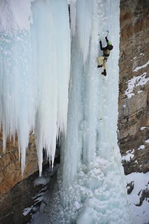https://imgc.artprintimages.com/img/print/a-man-ice-climbing-the-fang-an-ice-formation-on-the-side-of-a-cliff_u-l-psw05i0.jpg?p=0