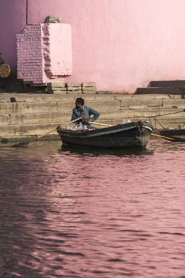 A Man in a Rowboat in Water Tinted Pink by Reflections of a Pink Wall-Jonathan Irish-Photographic Print