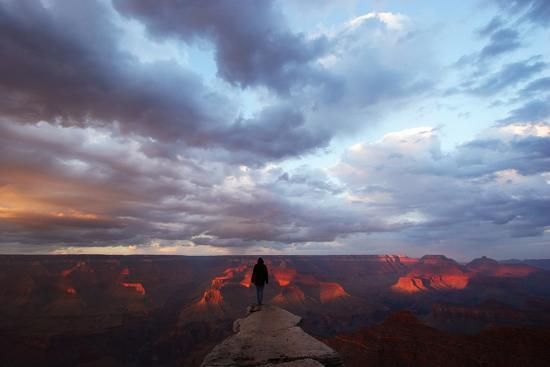 A Man Looking Out over the Grand Canyon at Sunrise from a Rock Promontory-Luis Lamar-Photographic Print