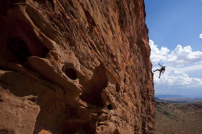 A Man Rappelling on the Red Rock Cliffs of Saint George, Utah-John Burcham-Photographic Print