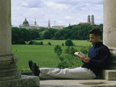 A Man Reads in the English Garden in Munich-Taylor S^ Kennedy-Photographic Print