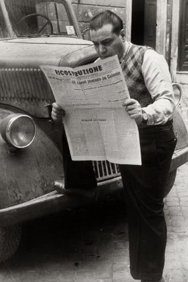 A Man Reads the Newspaper Ricostruzione with the Headline Allies Link Up Cologne-Luigi Leoni-Photographic Print