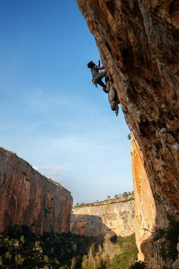 A Man Rock Climbs In The Beautiful Limestone Canyons Of Chulilla, Spain-Ben Herndon-Photographic Print