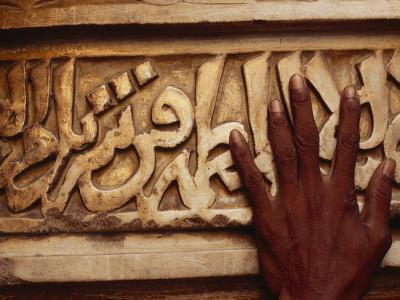 A Man Runs His Hand Over Arabic Script at the Famous Jama Masjid--Photographic Print