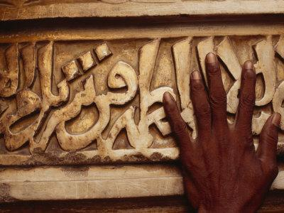https://imgc.artprintimages.com/img/print/a-man-runs-his-hand-over-arabic-script-at-the-famous-jama-masjid_u-l-p4oebu0.jpg?p=0