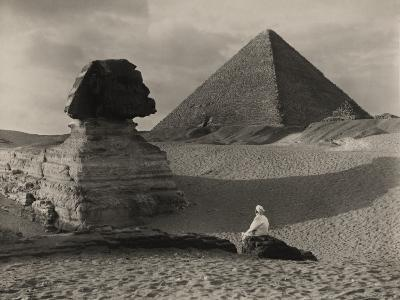 A Man Sits in Front of the Great Sphinx and Near the Cheops Pyramid-Donald Mcleish-Photographic Print