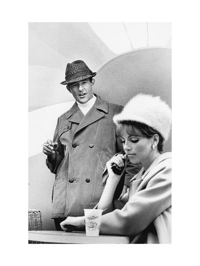 A Man Standing, Holding a Cigarette, and Looking Down at a Seated Woman-Horn Horn-Premium Giclee Print