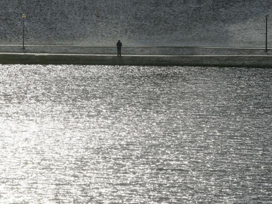 A Man Stands on the Banks of a Small Lake, Munich, on Friday, November 3, 2006.-Christof Stache-Photographic Print