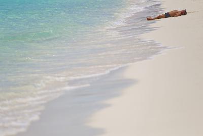 A Man Sunbathing on a Caribbean Sea Beach-Mike Theiss-Photographic Print