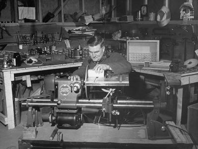 """A Man Using the New """"Shopsmith"""" a Multi-Purpose Power Tool for Carpentry Duties--Photographic Print"""