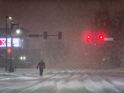 A Man Walking to Work Waits for a Red Light During a Predawn Snowstorm-Jim Reed-Photographic Print