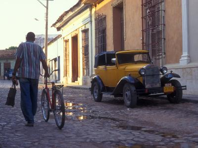 A Man Walks Down the Cobblestoned Street of This Tropical Island, Trinidad, Cuba-Taylor S^ Kennedy-Photographic Print