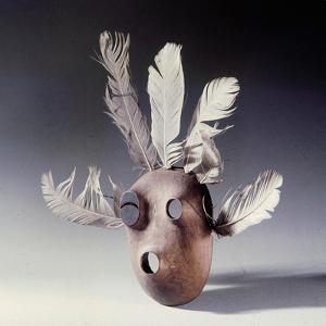 A Mask of Wood and Feathers Which Bears a Black Eye, Perhaps a Humorous Detail to the Shaman Who…