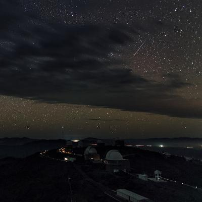 A Meteor Appears Next to the Beehive Star Cluster (M44) Above La Silla Telescope Domes-Babak Tafreshi-Photographic Print