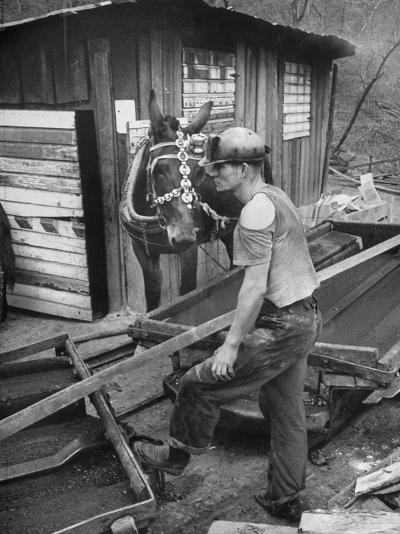 A Miner Standing with a Mule at the Rock House Coal Co. Mine--Photographic Print