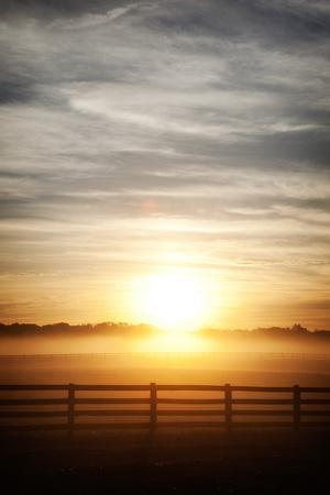 https://imgc.artprintimages.com/img/print/a-misty-dawn-over-a-rural-scene-in-loudon-county-virginia_u-l-psw0sd0.jpg?p=0