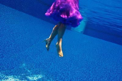 A Model Floats in a Pool, Wearing a Skirt and Heels-Heather Perry-Photographic Print