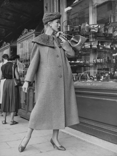 A Model Wearing a Coat with Fur Neck--Photographic Print