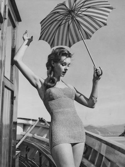 A Model Wearing a Swimsuit--Photographic Print