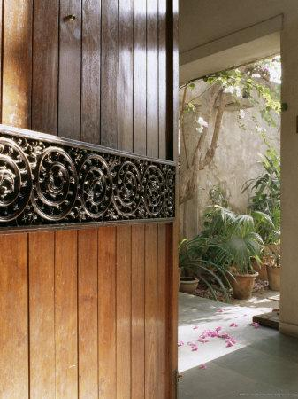 https://imgc.artprintimages.com/img/print/a-modern-front-door-decorated-with-a-400-year-old-piece-of-wood-carving_u-l-p1ukj20.jpg?p=0