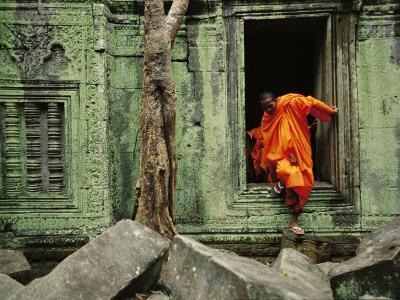 A Monk Emerges from the Doorway of an Angkor Wat Temple-Steve Raymer-Photographic Print