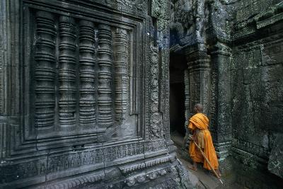 A Monk Explores the Ancient Ruins of the Angkor Wat Temple Complex-Paul Chesley-Photographic Print