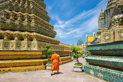 A Monk Walks Past Stupas at Wat Pho (Temple of the Reclining Buddha), Bangkok, Thailand-Jason Langley-Photographic Print