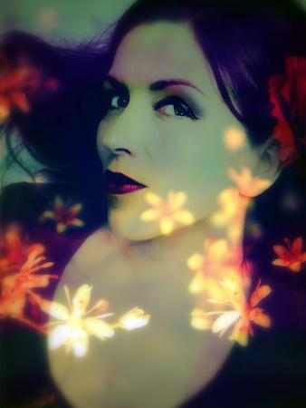 https://imgc.artprintimages.com/img/print/a-moody-evening-portrait-of-a-woman-with-bright-flower-appearence_u-l-q11ylj50.jpg?p=0