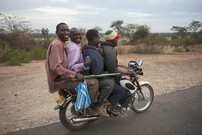 A Motorcycle Taxi Near the Town of Kasese in Uganda-Joel Sartore-Photographic Print
