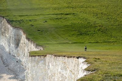 A Mountain Bike Cycling the South Downs Way Near Cliffs at Beachy Head-Alex Treadway-Photographic Print