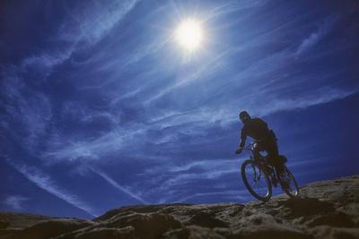 A Mountain Biker on Slickrock Trail Near Moab, Utah-David Hiser-Photographic Print