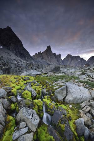 https://imgc.artprintimages.com/img/print/a-mountain-stream-coursing-through-moss-covered-boulders_u-l-psw1aa0.jpg?p=0
