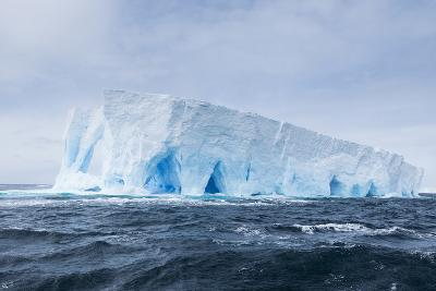 A Natural Arch Formation Inside a Tabular Iceberg-Jeff Mauritzen-Photographic Print