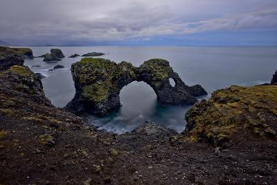 A Natural Arch in Sea Off the Coast of Iceland-Raul Touzon-Photographic Print