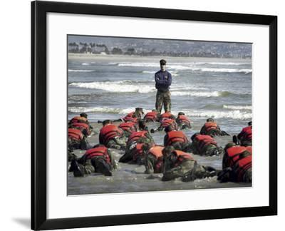 A Navy SEAL Instructor Assists Students During a Hell Week Surf Drill Evolution-Stocktrek Images-Framed Photographic Print