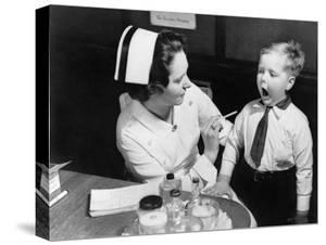 A Nurse Examining the Teeth of a Boy in New York, NY , Ca, 1935