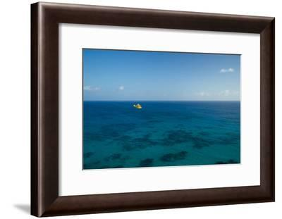 A PA18 Super Cub Floatplane Explores the Ocean Off Conception Island-Jad Davenport-Framed Photographic Print